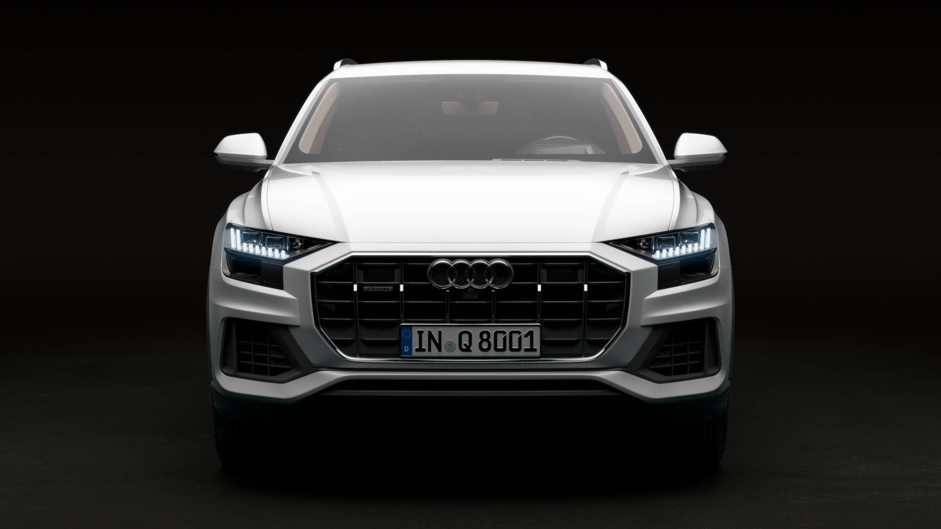 Green Audi Q8 product shot front view.
